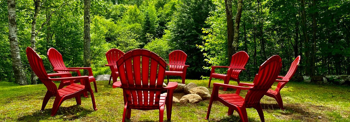 Red chairs around a fire pit